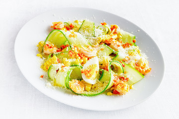 young corn, cucumber, egg, fried in garlic oil and chili shrimps salad sprinkled with lemon juice