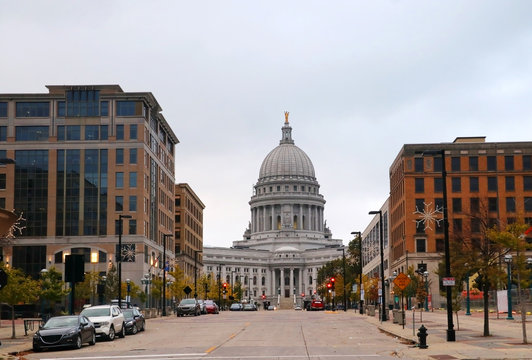 Madison downtown cityscape with State Capitol building.Beautiful autumn downtown street view from Monona Terrace with state capitol building against cloudy gray sky and official buildings. Madison, Wi