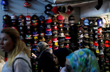Hats are displayed at the stall of a street vendor in Istanbul