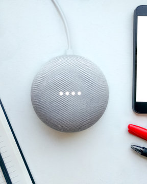 Smart speaker, smartphone and notepad. Digital assistant, flat lay.