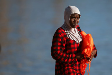 A migrant is seen after disembarking a rescue boat at the port of Malaga