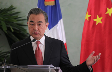 China's Foreign Minister Wang Yi talks to the media in Santo Domingo