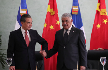 China's Foreign Minister Wang Yi and Dominican Republic's Chancellor Miguel Vargas shake hands after signing a bilateral agreement in Santo Domingo