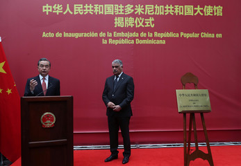 China's Foreign Minister Wang Yi speaks next to Dominican Republic's Chancellor Miguel Vargas during the opening of a new Chinese Embassy in the Dominican Republic
