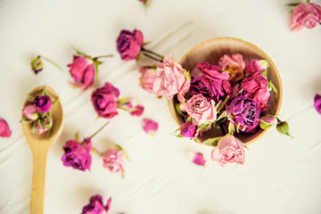 Dried rose petals: for tea, alternative medicine, pot-pourri. Copy space.