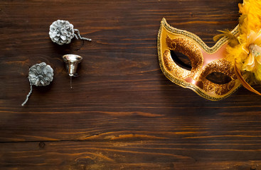 .Christmas  decor. Venetian festive brilliant mask  on wooden background, concept of New Years holiday or carnival, closeup, copy space