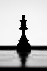 King chess piece silhouette on a white background