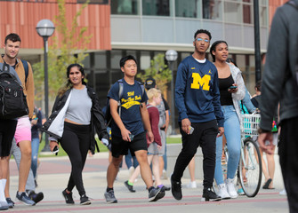 Students walk on campus at the University of Michigan in Ann Arbor