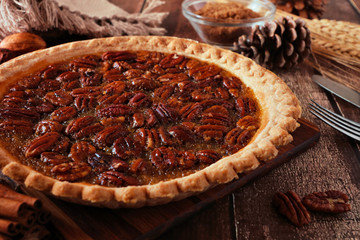 Homemade pecan pie, close up table scene with a dark rustic wood background