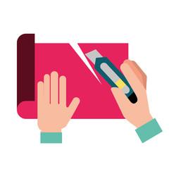 graphic designer hands cutting a paper