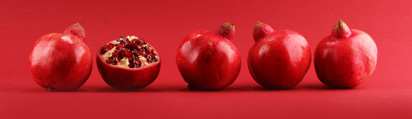 Ripe Pomegranates. sliced and whole pomegranate on a table.