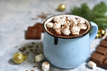 Wall Murals Chocolate Homemade festive hot chocolate in a blue vintage cup.