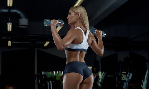 A young smart girl posing in the gym.