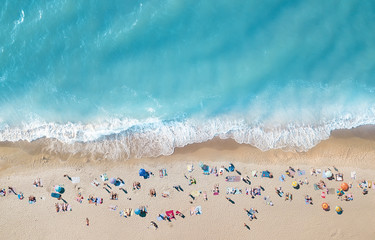 Papiers peints Plage Aerial view at the beach. Turquoise water background from top view. Summer seascape from air. Top view from drone. Travel concept and idea