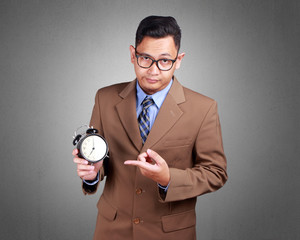 Young Businessman Showing Time, Serious Expression