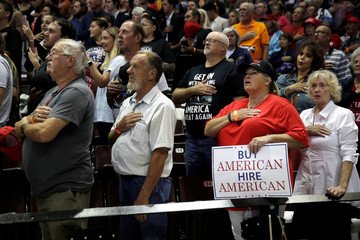 Supporters of U.S. President Donald Trump receive the Pledge of Allegiance at a campaign rally in Springfield