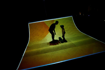 Poeple interact with an installation during the Lumina Light Festival in Cascais