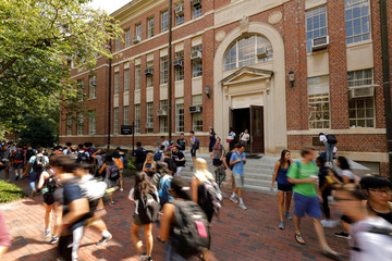 Students walk past a classroom building on the campus of the University of North Carolina at Chapel Hill North Carolina