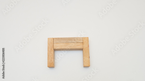 Wall mural wooden block on white background