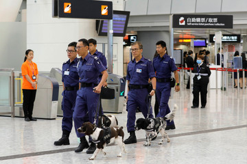 Policemen lead dogs to search West Kowloon terminus, the venue of the opening ceremony of the Hong Kong Section of the Guangzhou-Shenzhen-Hong Kong Express Rail Link, in Hong Kong