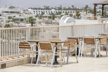 Table and chairs in beach cafe next to the red sea in Sharm el Sheikh, Egypt