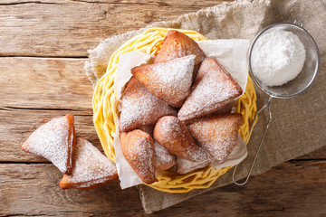 Mandazi, also known as thedaboorSouth Sudanese Coconut Doughnut close-up in a basket. Horizontal top view Wall mural