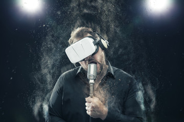 Businessman wearing virtual reality glasses and singing