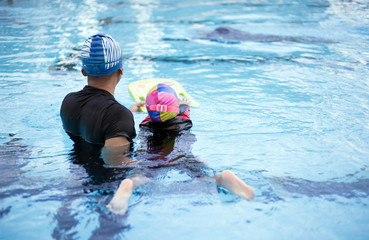backyard of swimming coach activity in swimming pool