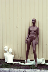 mannequins in the trash on the street