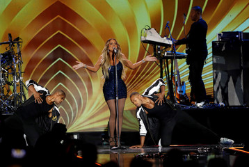Mariah Carey performs with dancers during the iHeartRadio Music Festival at T-Mobile Arena in Las Vegas
