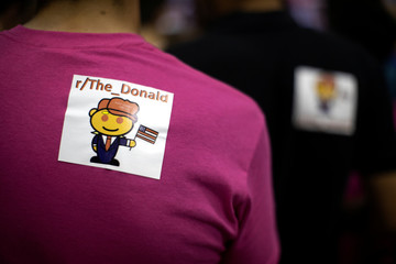 Supporters of U.S. President Donald Trump wear stickers on their backs at at campaign rally in Springfield