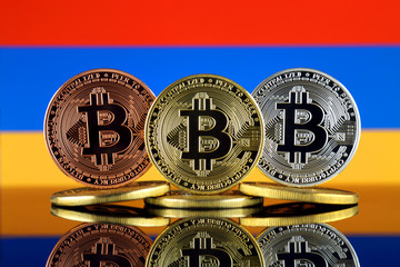 Physical version of Bitcoin (BTC) and Armenia Flag. Conceptual image for investors in High Technology (Cryptocurrency, Blockchain Technology, Smart Contracts, ICO).