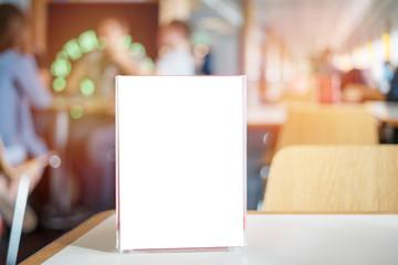 Menu frame on table in restaurant cafe bar, mock up