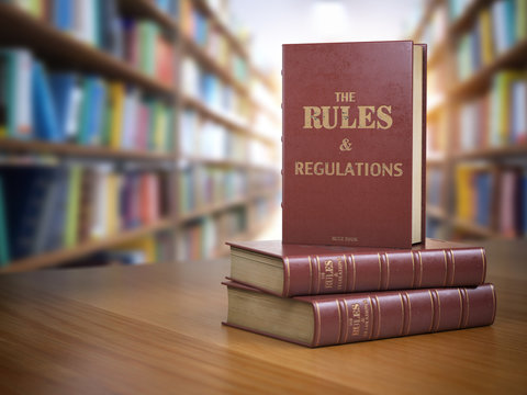 Rules and regulations books with official instructions and directions of organization or team.