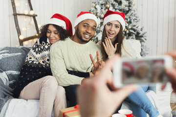 Friends capturing lovely Christmas moment