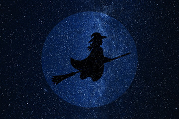 Silhouette of witch flying on broomstick against background of night sky and full moon.