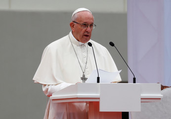 Pope Francis addresses at the front of the Presidential palace in Vilnius