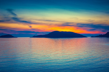 Bright color sunset over blue sea