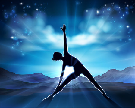 A woman in a yoga or Pilates position in silhouette with the sunrise behind her background concept