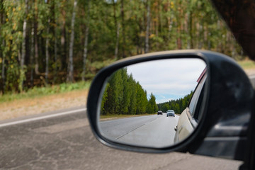 look in the rear view mirror of a car