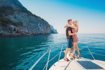 Couple on a Yacht. Luxury vacation on the Boat young man and woman. Sailing the Sea.
