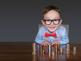 Excited child businessman with money