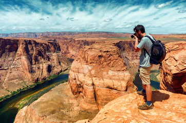 traveler looks at Horseshoe Bend in Utah, USA