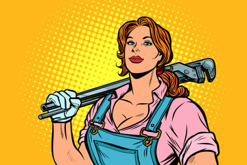 A strong woman mechanic plumber worker with adjustable wrench