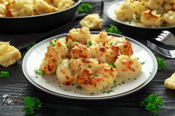 Roasted cauliflower with cheddar cheese sauce and herbs.