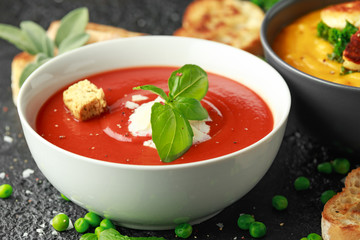 Tomato and fresh basil soup with garlic, cracked pepper corns, served with parmesan cheese, toast bread