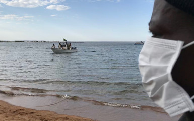 Tanzanian police and rescuers transport bodies of passengers retrieved after a ferry MV Nyerere overturned off the shores of Ukara Island in Lake Victoria