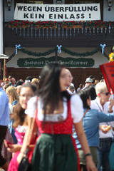 Visitors seen during the opening day of the 185th Oktoberfest in Munich