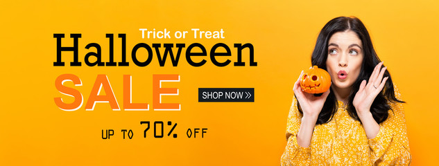 Halloween sale with young woman holding a pumpkin Wall mural