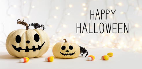 Happy Halloween message with pumpkins with spider on a shiny light background